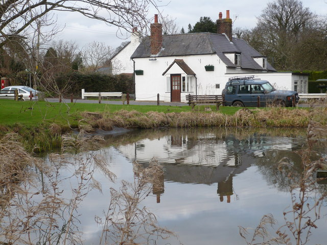 The Carpenters' Arms, Coldred, reflected in the pond