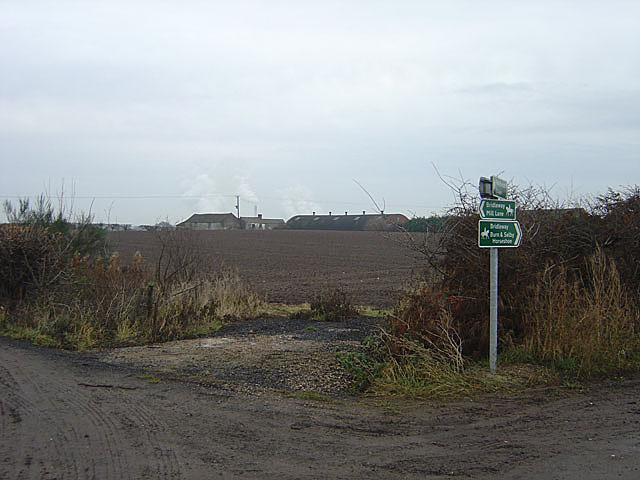 Footpath and bridleway signpost near Burton Hall
