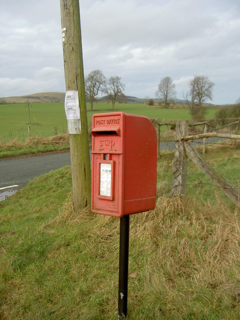Post-box by the road junction.