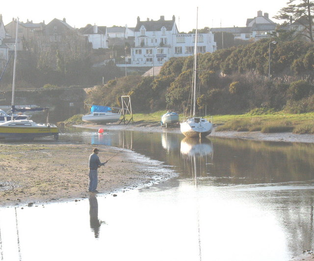 Angler fishing in Abersoch Harbour at low tide