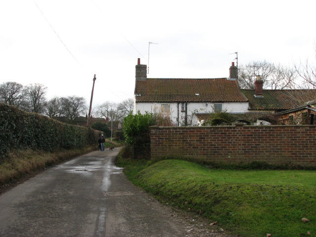 Southwest past houses on Marshgate