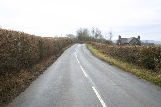Road passing The Highgrove