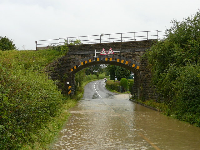 The A359 railway bridge at Wanstrow flooded