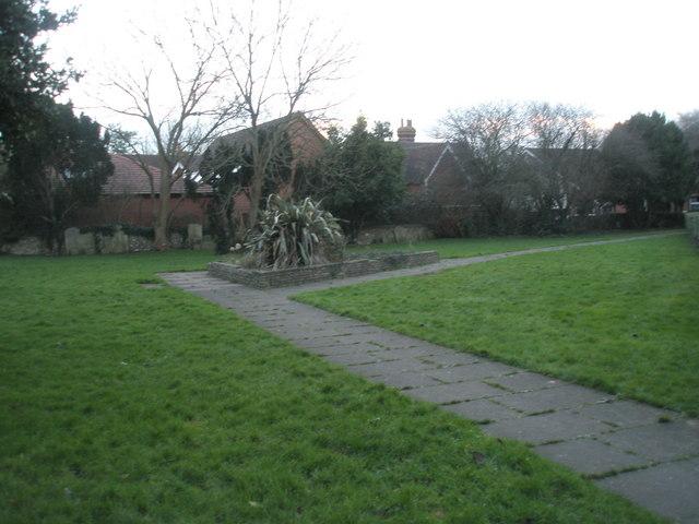 Triangular flower bed in Emsworth churchyard