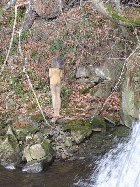 The sculpture beside the waterfall