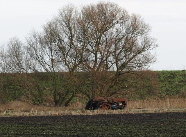 Derelict Tractor Next To Drain