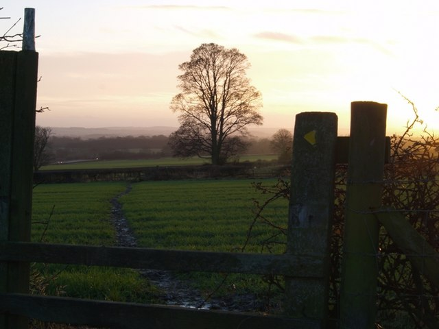 Stile into another muddy field