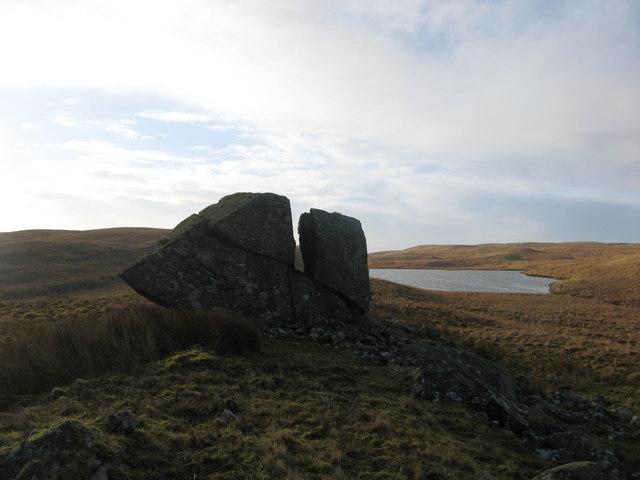Boulder on Esgair Pentanau with Llyn Cerrigllwydion Isaf