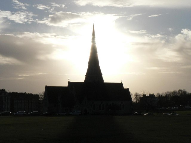 Blackheath: All Saints' spire against sun