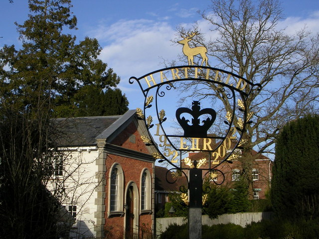 Village sign, with chapel in the background