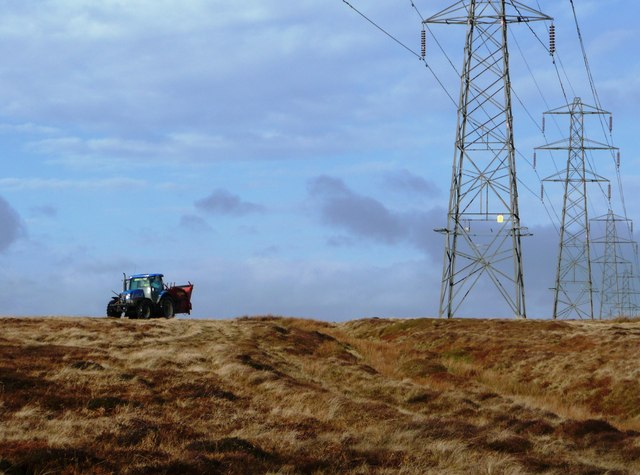 Pylons and a tractor on Mynydd Twyn-glas
