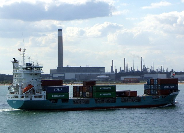 A small container ship entering Southampton Water
