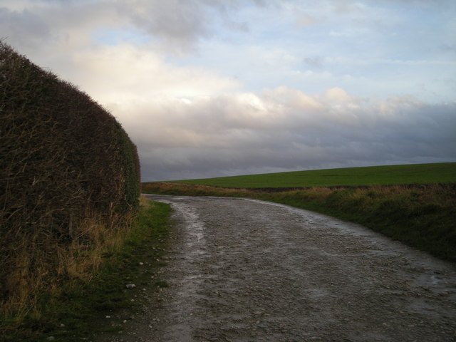 Could be almost anywhere! It is the track to Betton Abbots Farm.