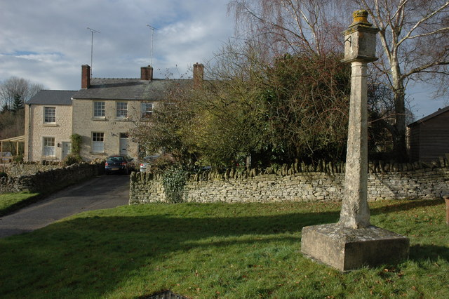 Sundial and houses in Coberley