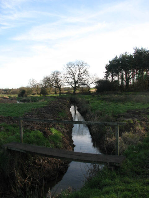 Footbridge across drainage ditch