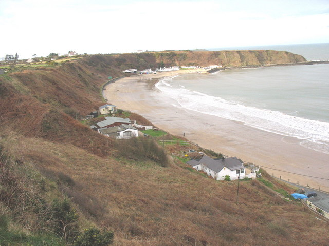Clap-board beach chalets at Nefyn