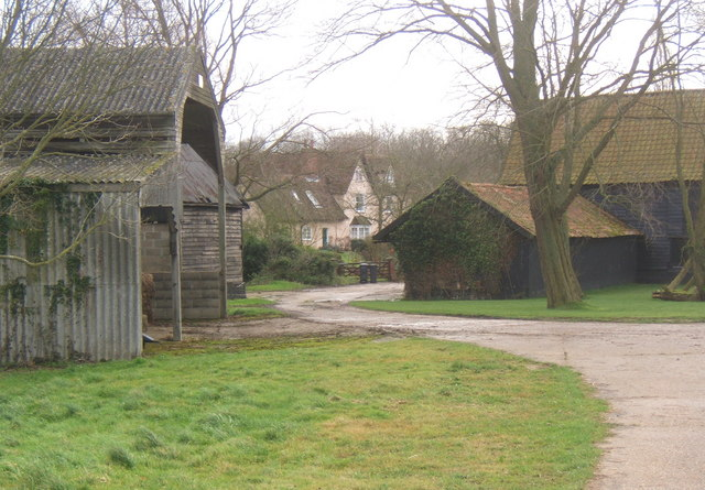 Glimpse of Tarston Hall past outbuildings
