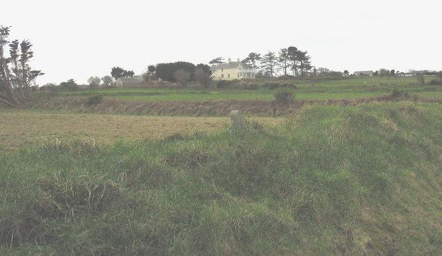 View across cliff edge fields towards Ty'n y Pwll