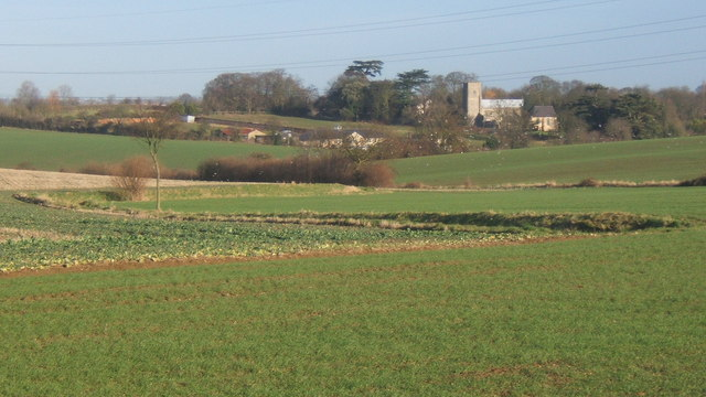 Fields with distant view of Barking church
