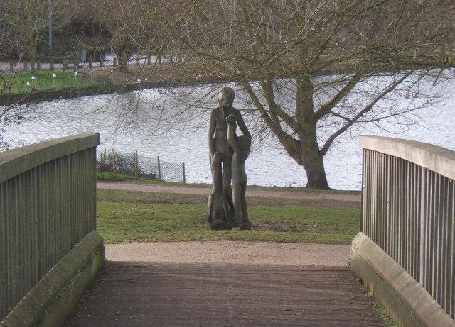 Footbridge and sculpture by Needham Lake