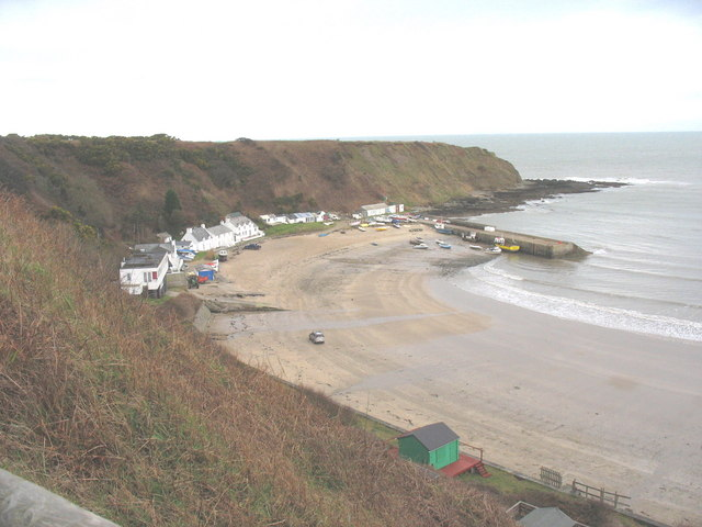 A car is driven along the strand in the direction of Porth Nefyn hamlet