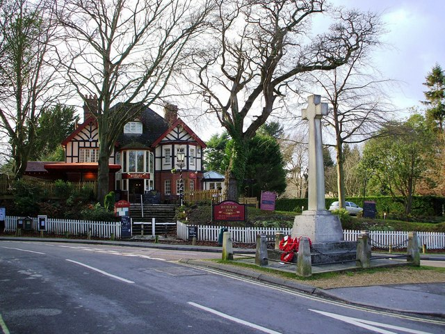 Burley War Memorial with the Burley Inn behind
