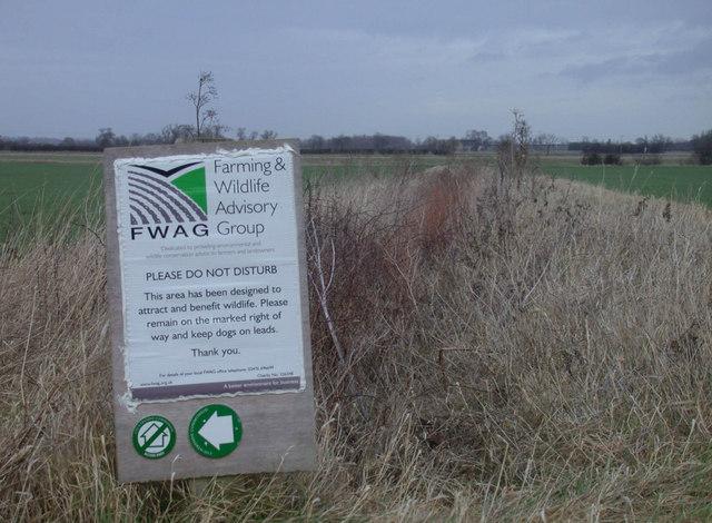 Explanatory sign beside permissive footpath
