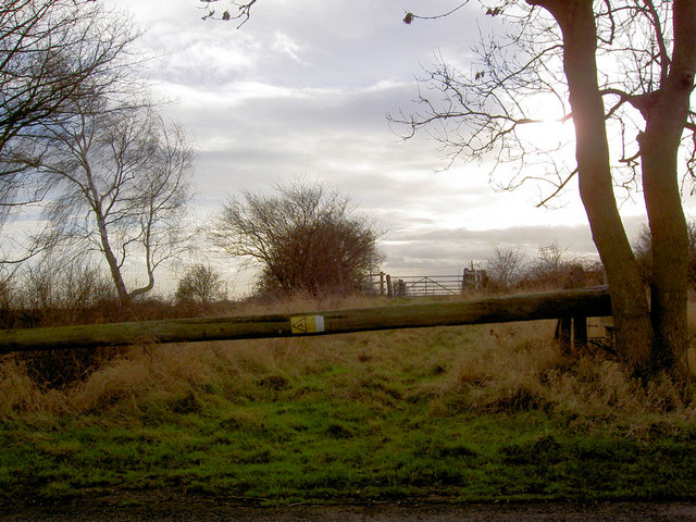 Old  power line pole used as a gate/barrier  leading to bridge over disused railway