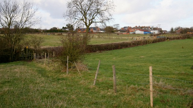 Public footpath and course of old railway
