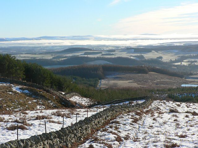 Boundary wall and view across Glen Earn