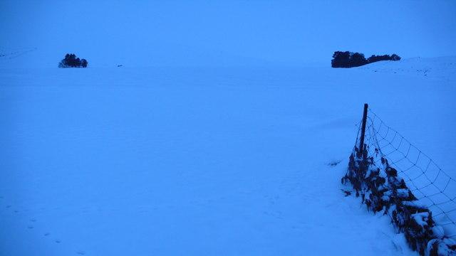 Fenceline leading into frozen Loch Con