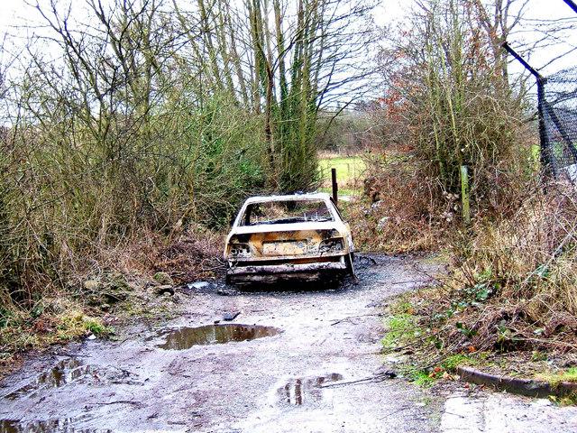 Abandoned vehicle near Oldington Bridge