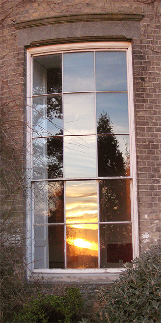 Sunset in a curved window