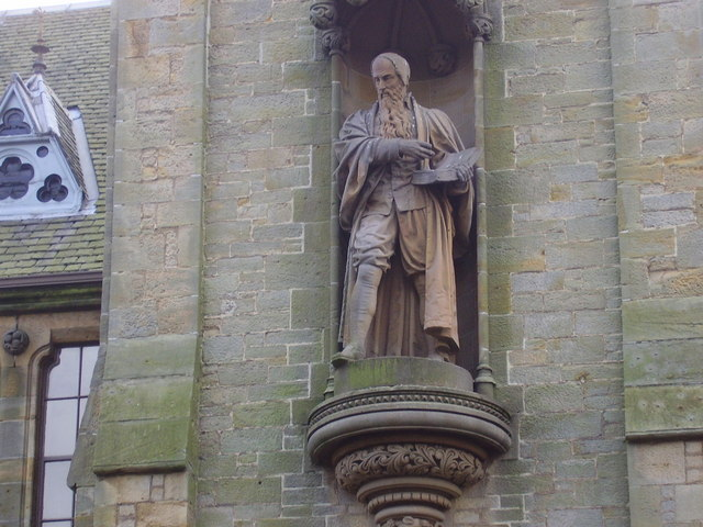 Statue of John Knox on the tower of the Knox Institute in Haddington
