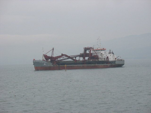The dredger City of Cardiff passes the Porth Penrhyn channel marker