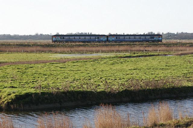 Wherry Line on track beside Haddiscoe New Cut
