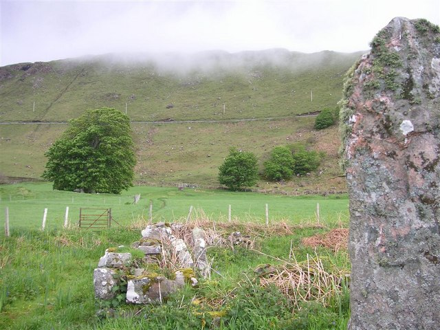 Standing stone by a graveyard