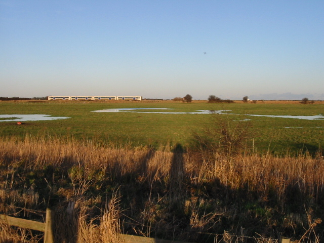 View across farmland to the railway line