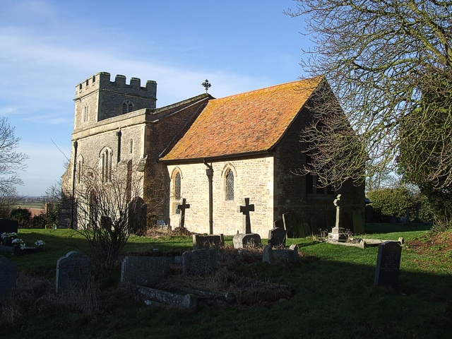 St. Michael's & All Angels in its churchyard