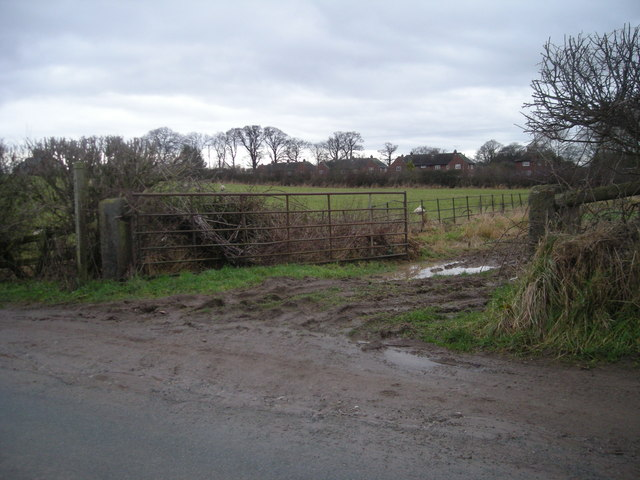 Entrance to footpath across muddy field