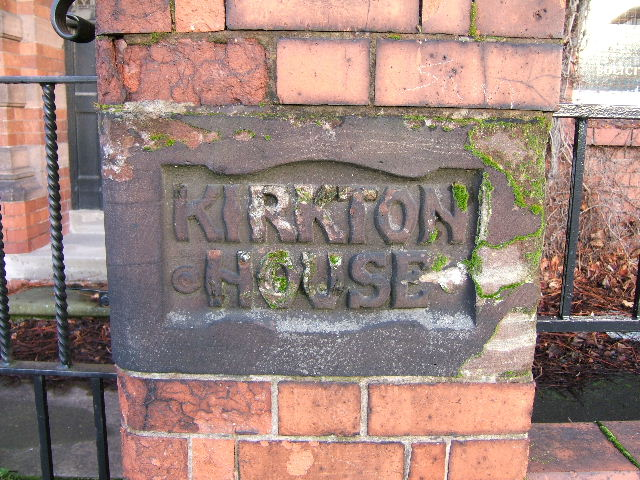 House Sign carved in sandstone