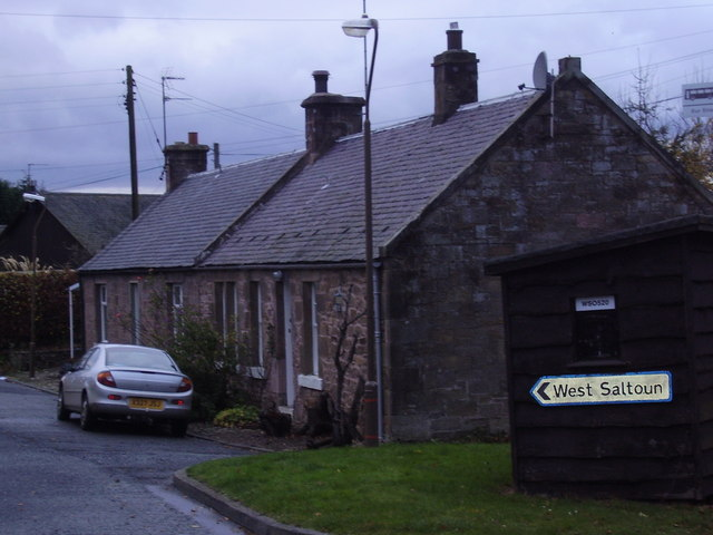 Road sign and cottages at West Saltoun