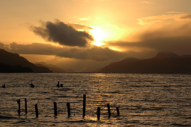 Pier remains at sunset beside Dores Inn