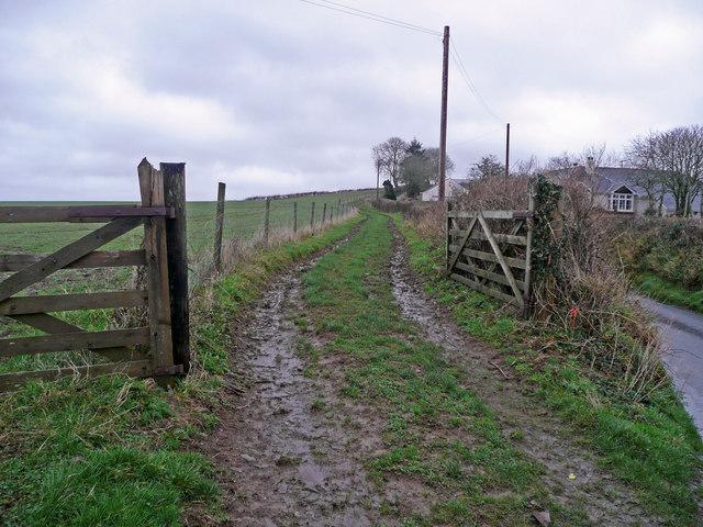 Muddy track to Woodville Farm