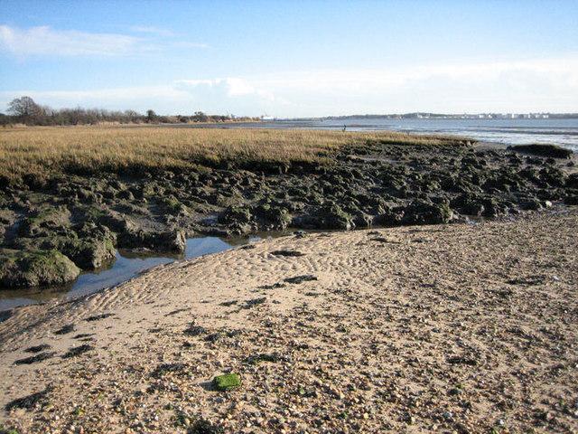 Pebble bank meets mud flats