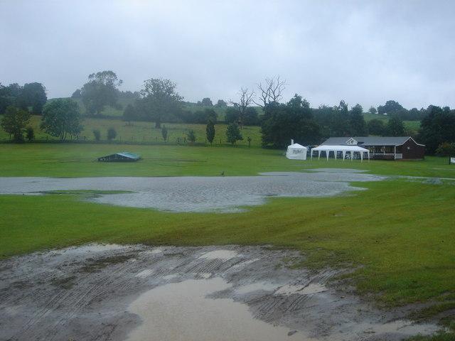 Cricket ground under water showing Old John behind