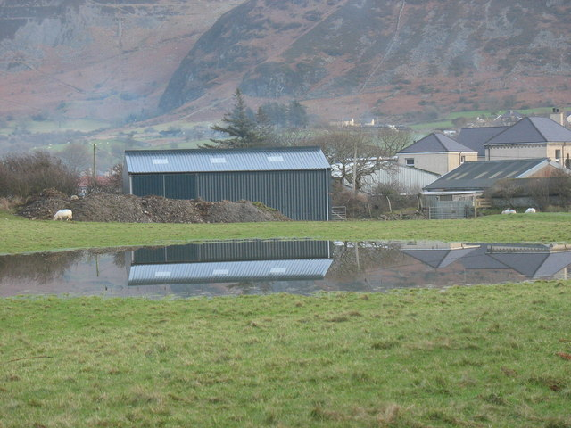 Farm shed reflected in flood water