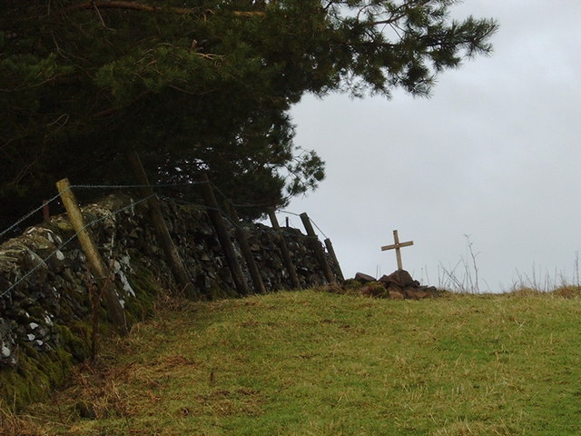 Grave in a sheep pasture