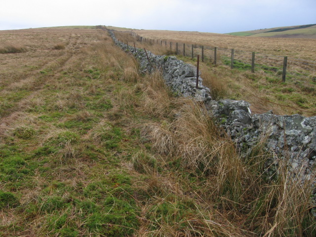 Wall and fence to hill top