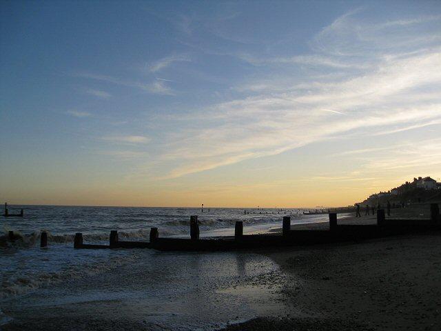 Setting winter sun over the groynes